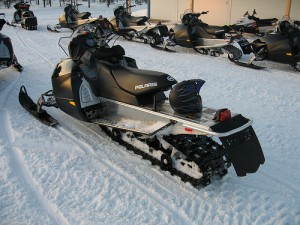 Some snowmobiles can move at speeds up to 150 mph (240 km/h). Iditarod sled dogs have been killed by snowmobiles. Photo attributed to janandersen_dk on flickr