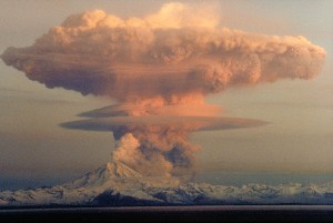 April 21, 1990 eruption cloud from Mount Redoubt Volcano. The Alaska Volcano Observatory said that dogs should not breathe in the fine glass-like particles found in Redoubt's emissions. Photo attributed to wikimedia